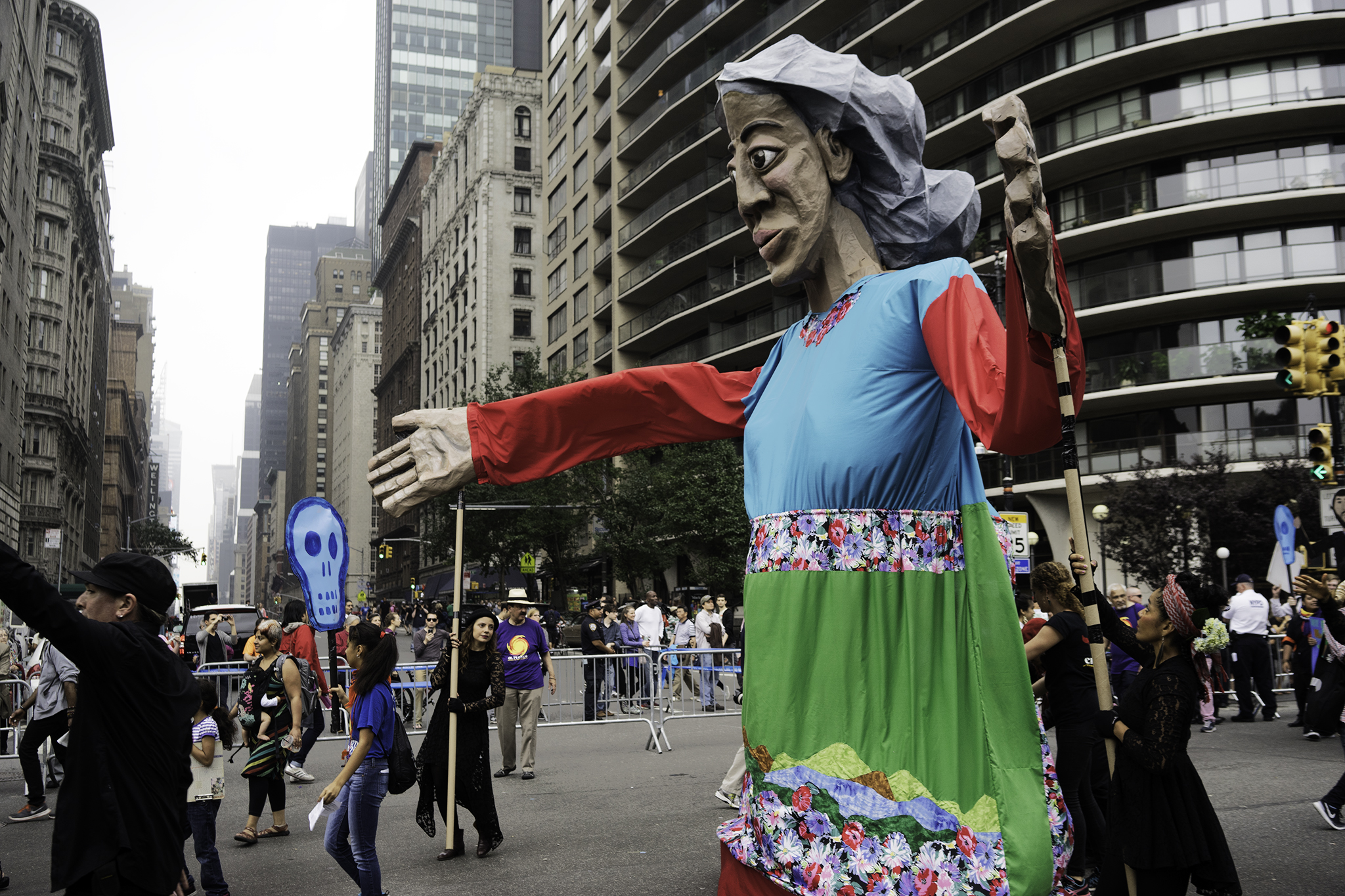 "Latino-Americans parading with ""Madre Tierra."""