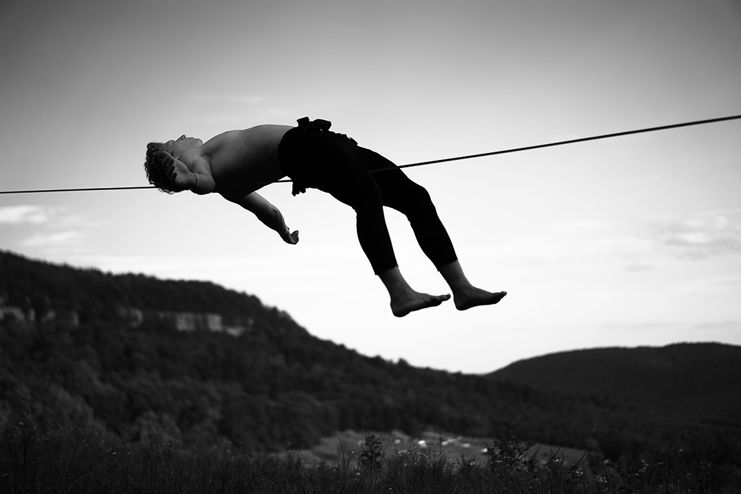 A climber reclines on a 100ft slack line in Horseshoe Canyon Ranch, AR