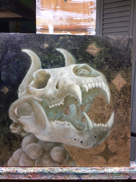 When I switched the horns around, i sanded the area, which left a strange glossy spot on the surface. I resolved this issue by adding a thin layer of black glitter. It covered that error and created a nice texture around the top of the skull.