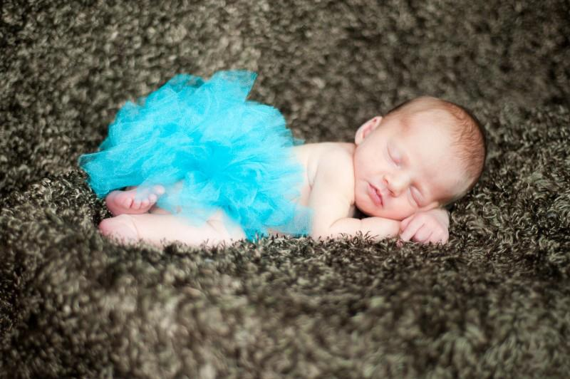 Her amazingly talented   Aunt Jeni   took this picture of her in her teal tutu. I think it is the perfect image to hang over the sofa in what is quickly becoming the teal/green Dip Room.