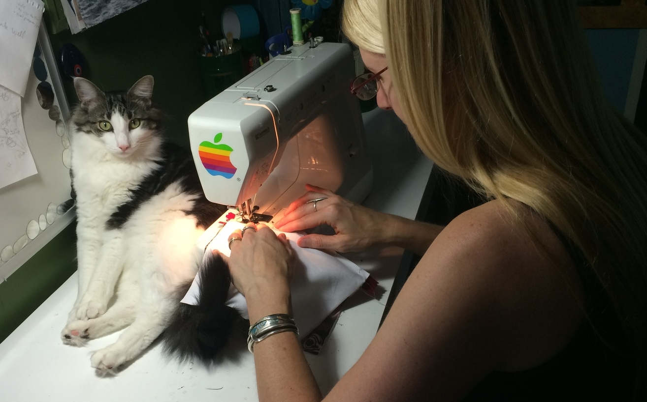 Boo closely supervises my work flow as I concentrate on making a straight stitch.