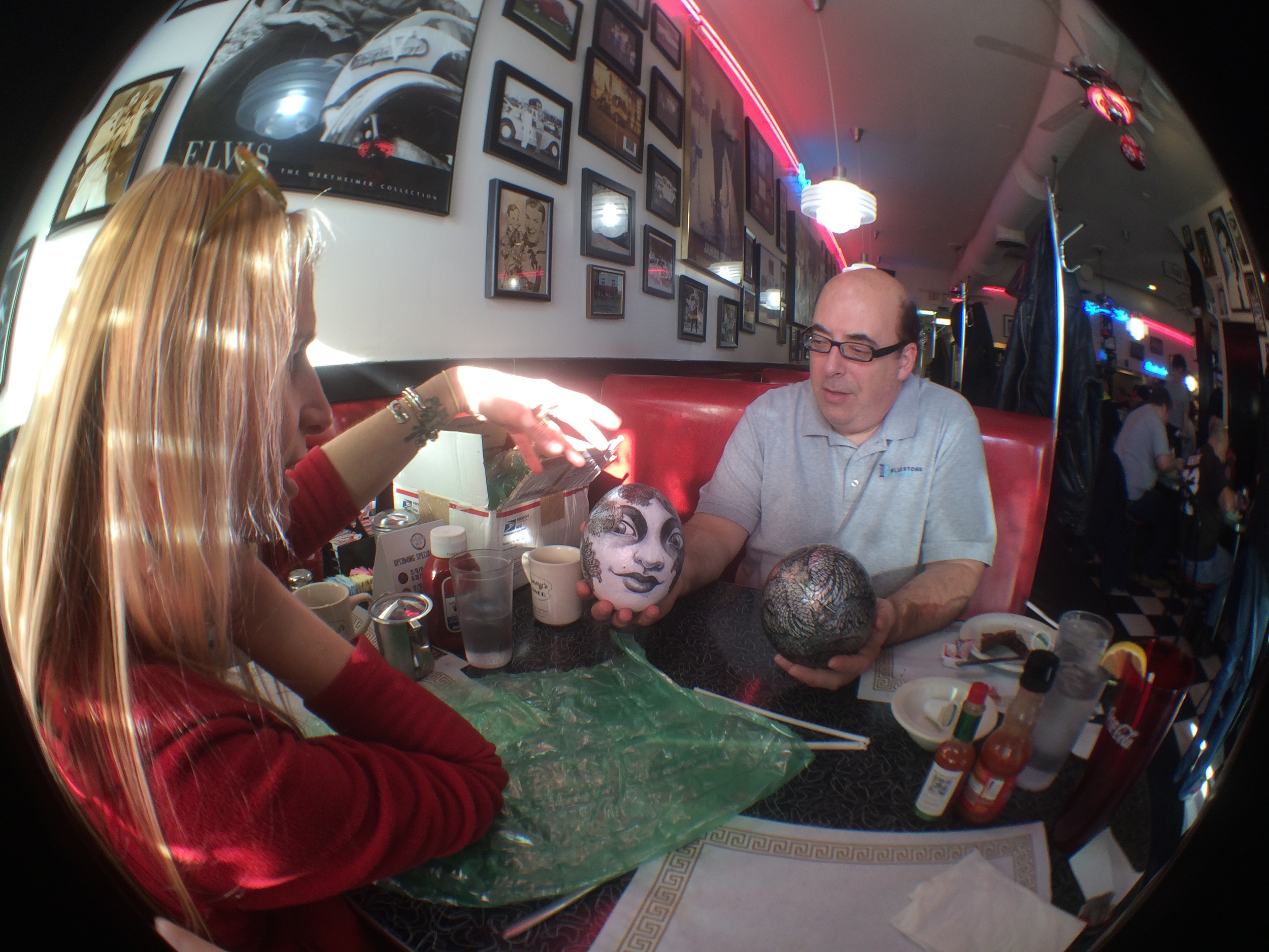 Discussing techniques with Charles Bluestone at Tommy's Diner in Columbus, OH. The egg in his left hand, the male companion to the female shown,will be included in the exhibit.