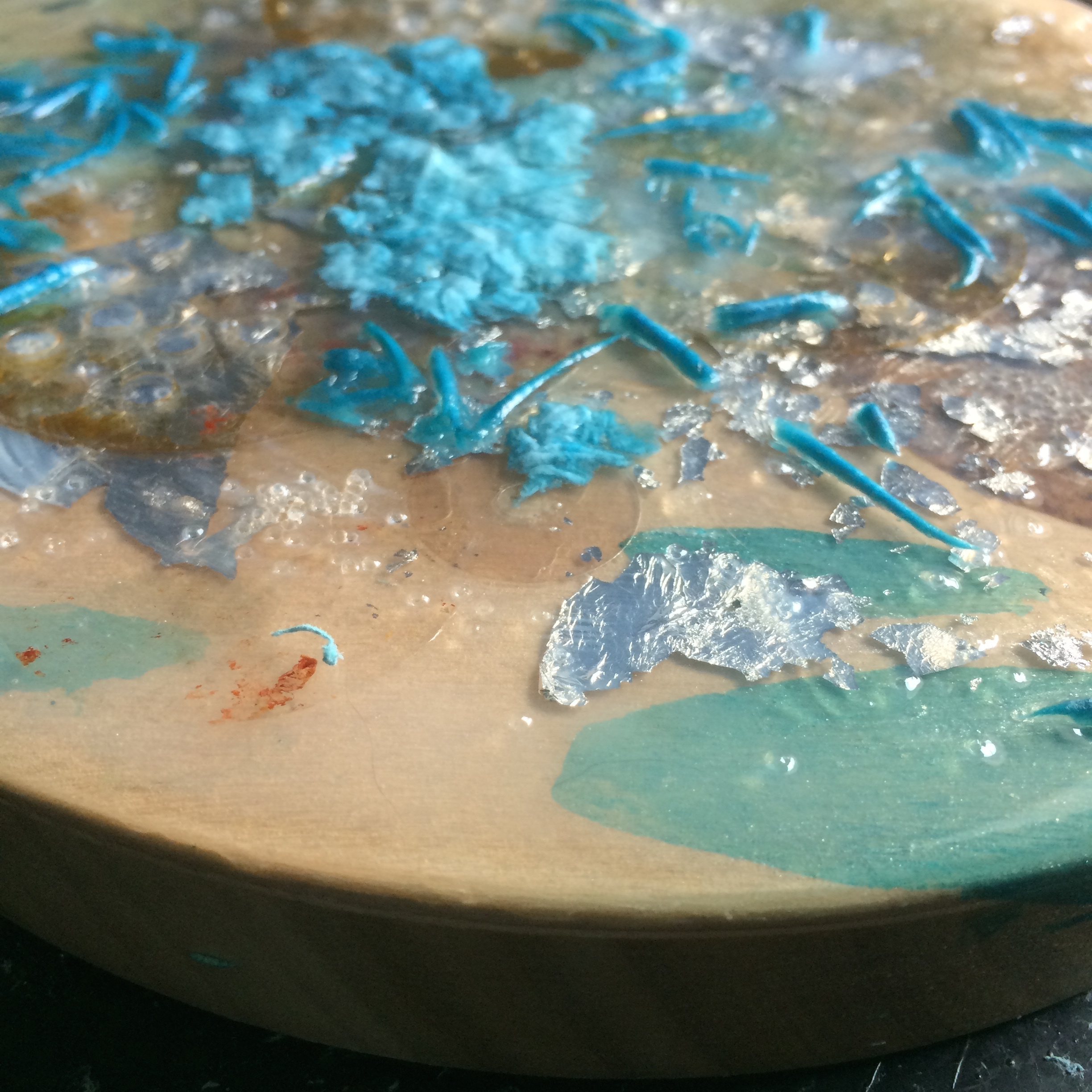 Embedding the paper waste into some pouring medium.