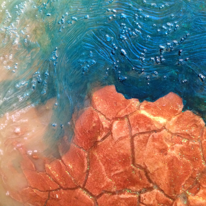 Crackle Medium 'island' with glass bead 'water.'