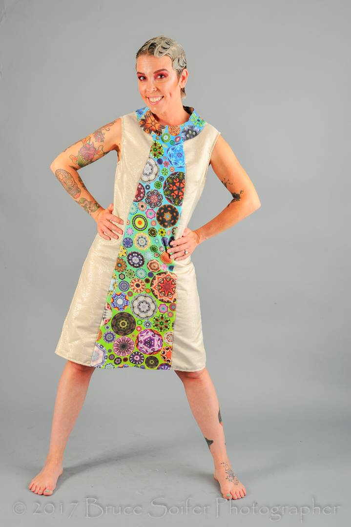 Stephanie is wearing this mod dress, which was created using an altered pattern. The gold fabric was a thrift store find and the center/collar are my  Kaleidoscope Circles II Rainbow  design in organic cotton.