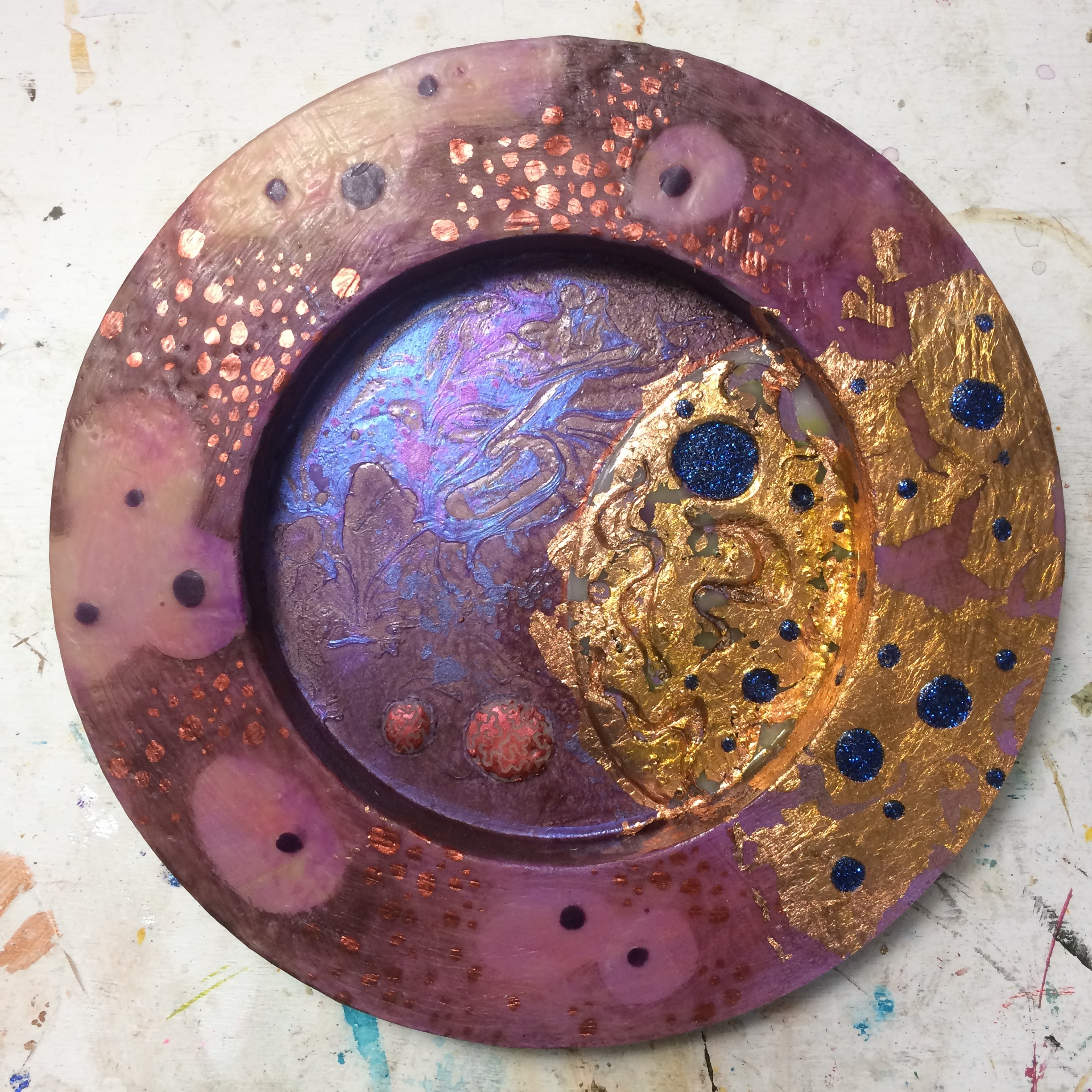 (K) Waxed and carved over circle. Wax pan pastel dots. (A) Glitter, copper foil, acrylic.