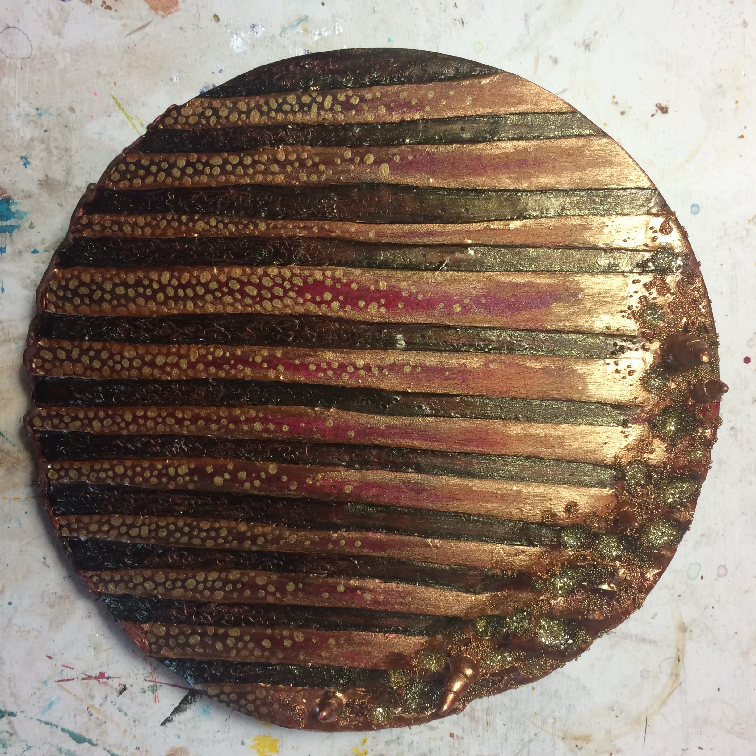 (A) Gold dots, glitter and acrylic glazes.