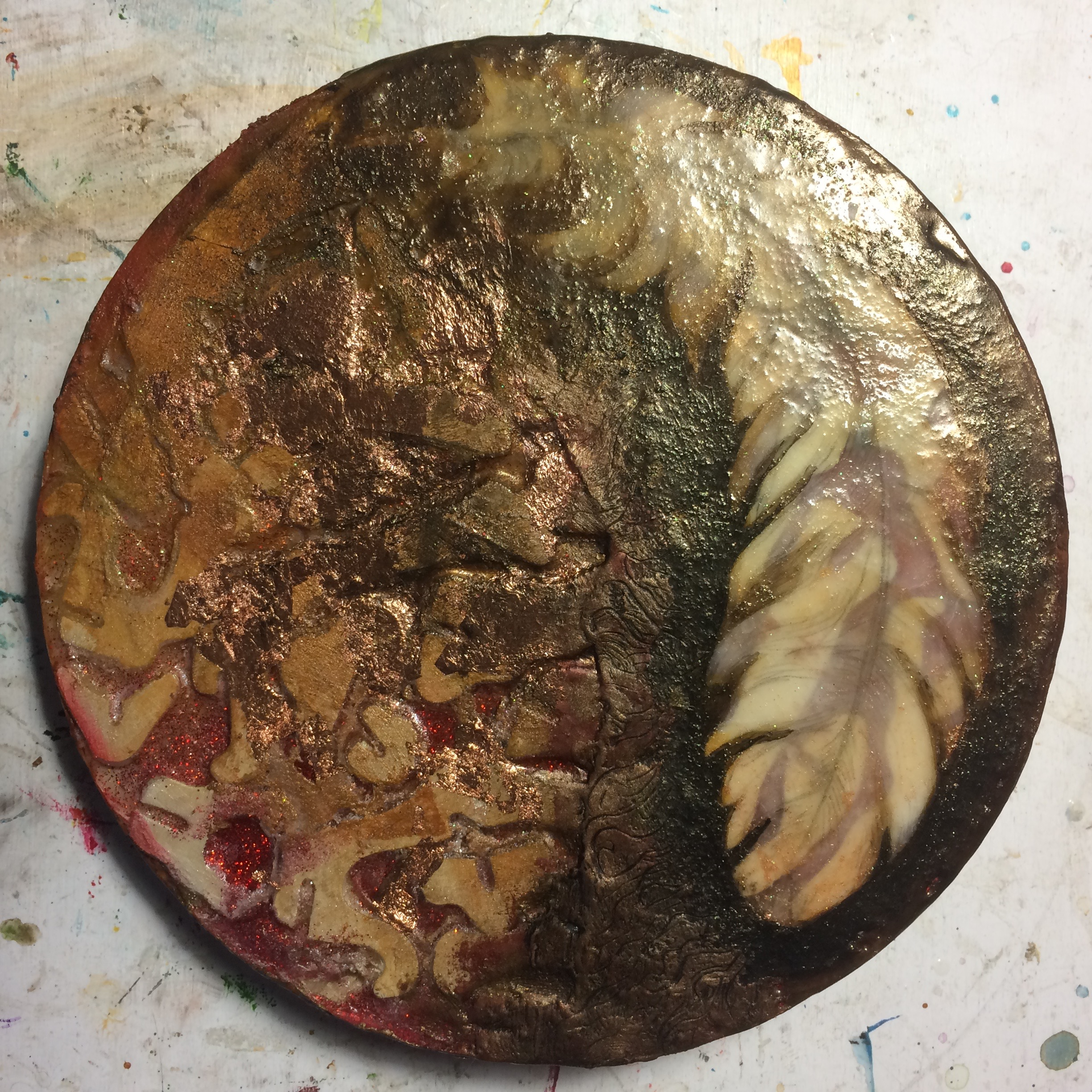 (K) Wax, pan pastel, pigment around edge and center, incised. (A) Defined feather edges, highlighted pieces.