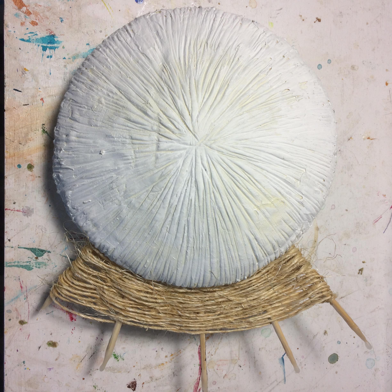 (K) Bamboo sticks, jute woven between.