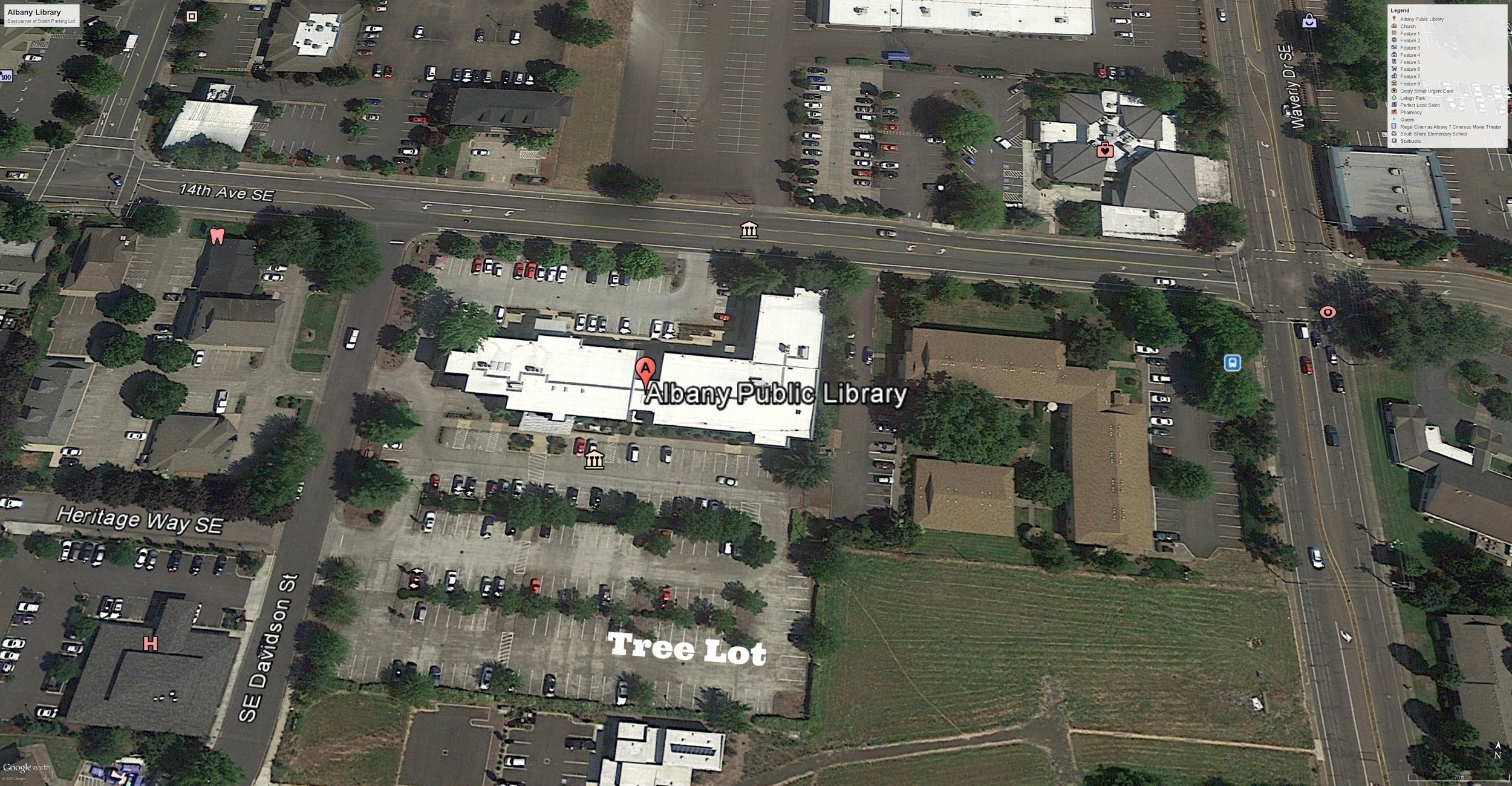 Albany Library (building center). Christmas Tree Lot (bottom center), 14th Ave SE running west (upper left) to east (upper right) and Waverly running north (top right) to south (bottom right). Parking lot entry on Davidson (center left).