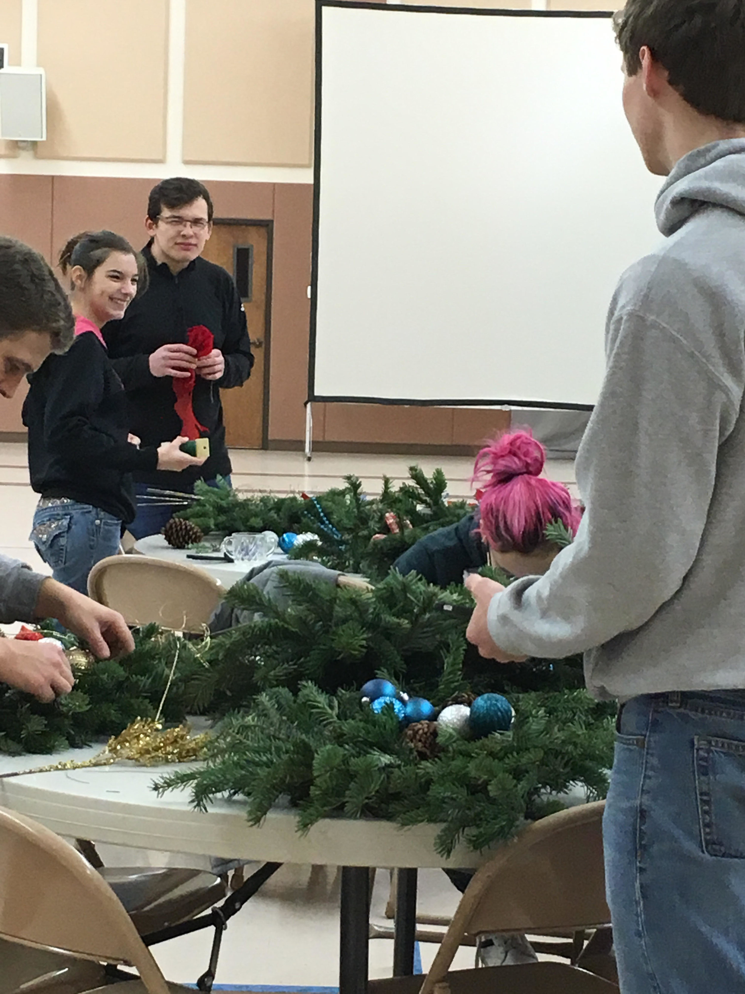 Youth Volunteers at  Albany Mennonite Church  (AMC) constructing wreaths for Albany Helping Hands.