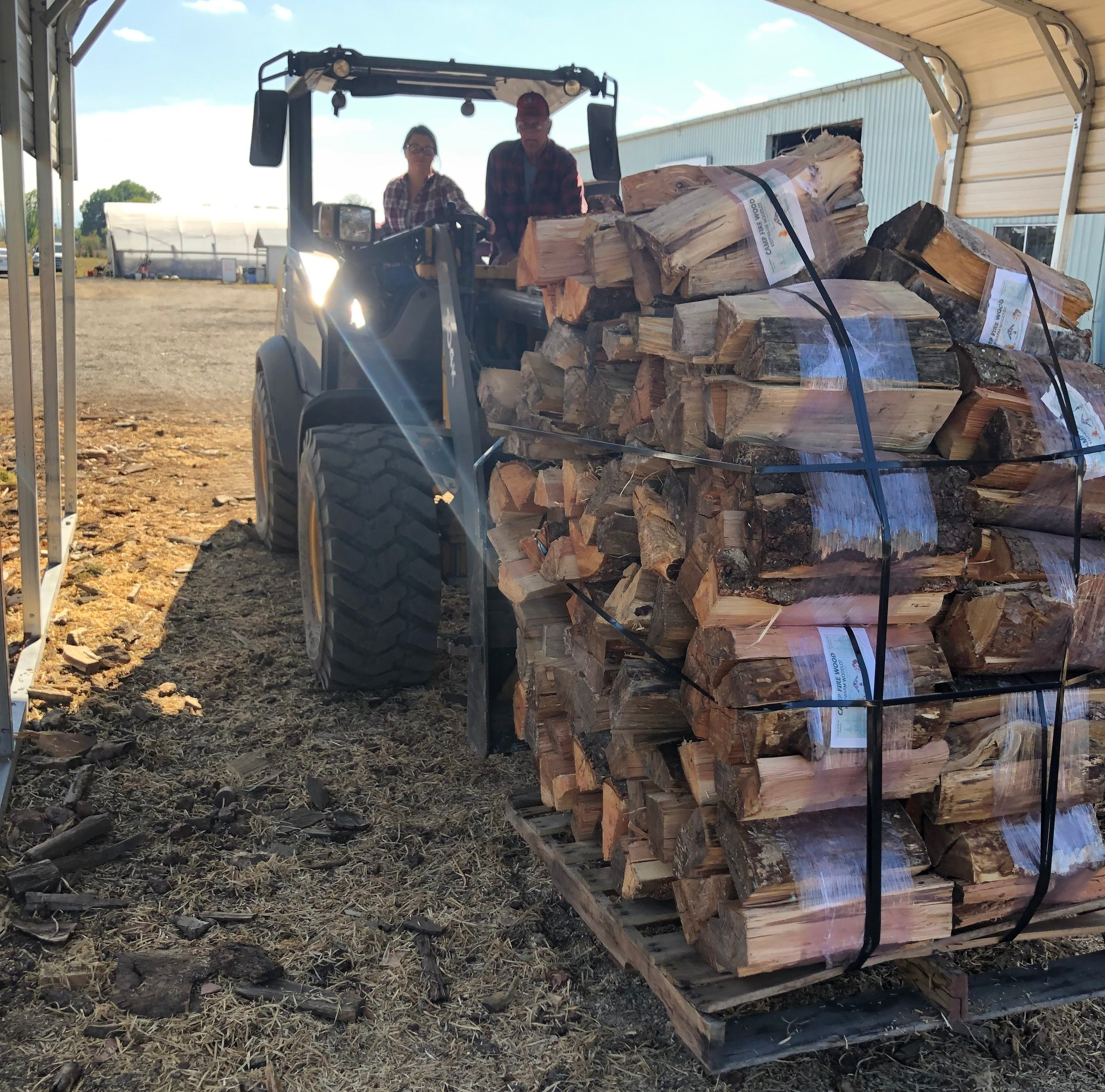 Farm Manager Emma Dean moving a load of Campfire Wood Bundles. Our Campfire wood is sold at 17 regional Coastal Stores, Waterloo and select Linn County Campgrounds and at our  woodlot .