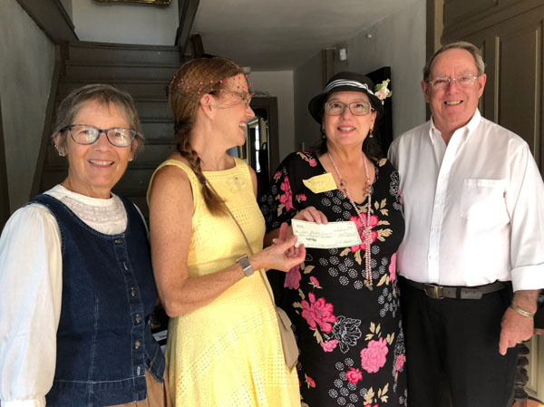 Tea Party Exceeds All Expectations —$5000.00 Raised - Pictured from left to right: Becky Eliot Keating ASH Board Member; Tess Edge, Event Sponsor; Cathy Weiss, Matching Donor; and Bob Bruch, ASH Board Member.