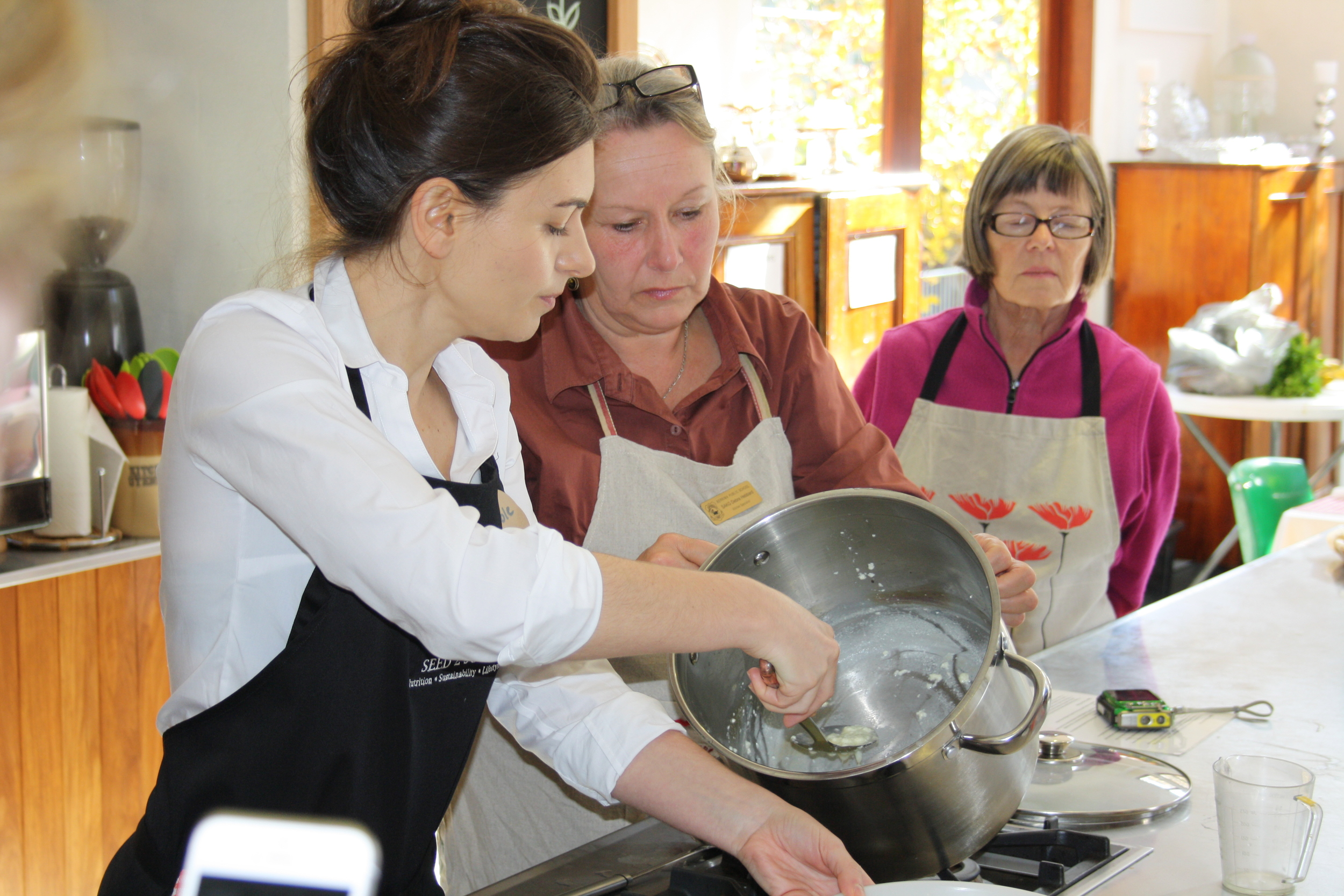 6 Nicole removing the ricotta curd into a hoop for straining.JPG