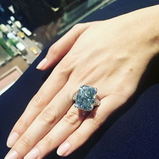 Christie's image of the stone being worn, which gives a good idea of its size.