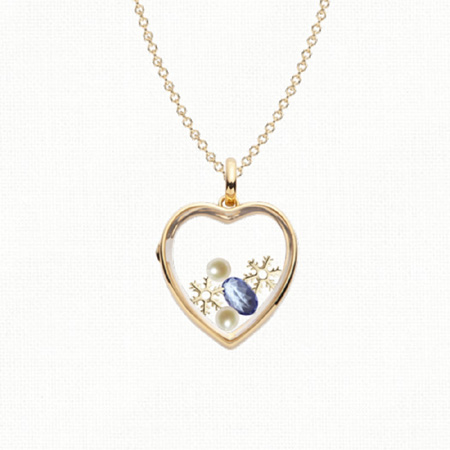Contemporary locket by Loquet, filled with winter symbols.