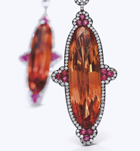 An important pair of Imperial topaz earrings by JAR.  It is usual for these stones to be cut in an elongated manner in order to show the colour off to its best advantage.