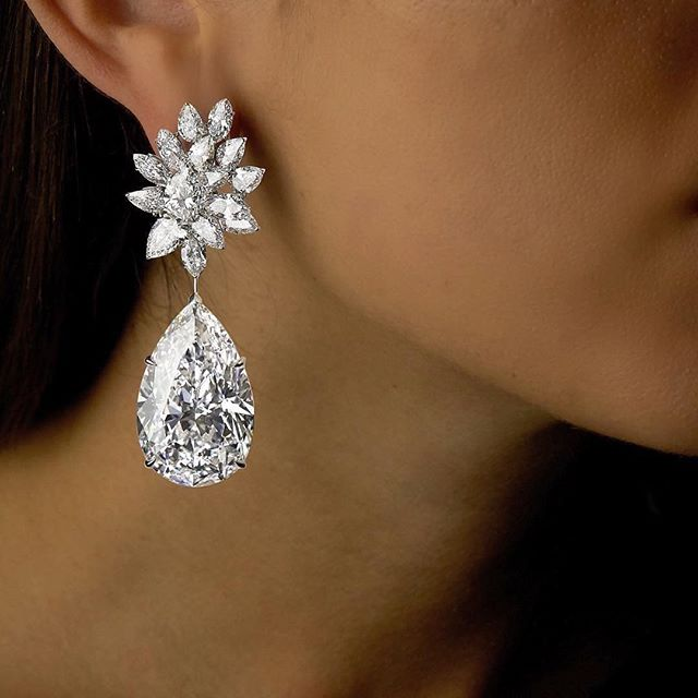 Miroir d'Amour earrings by Boehmer et Bassenge. Each of these pear shaped diamonds is D Flawless and weighs over 50 carats. They are the largest of their kind ever to be offered at auction.