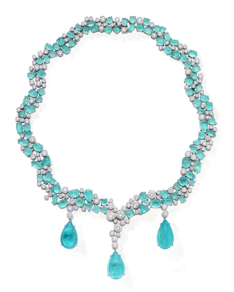 A unique Paraiba tourmaline necklace by Martin Katz. Note that the stones have been cut cabochon- this in no way detracts from their beauty.