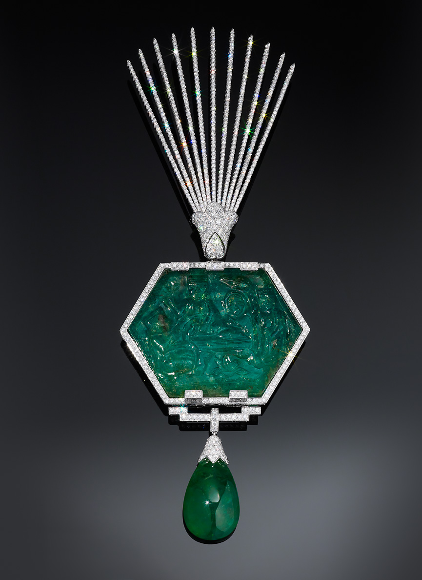 A magnificent turban ornament by Cartier made in the 1920s.  The central emerald was an Indian heirloom emerald reset into a neo Indian design that successfully married the best elements of modern Art Deco and traditional Moghul design.