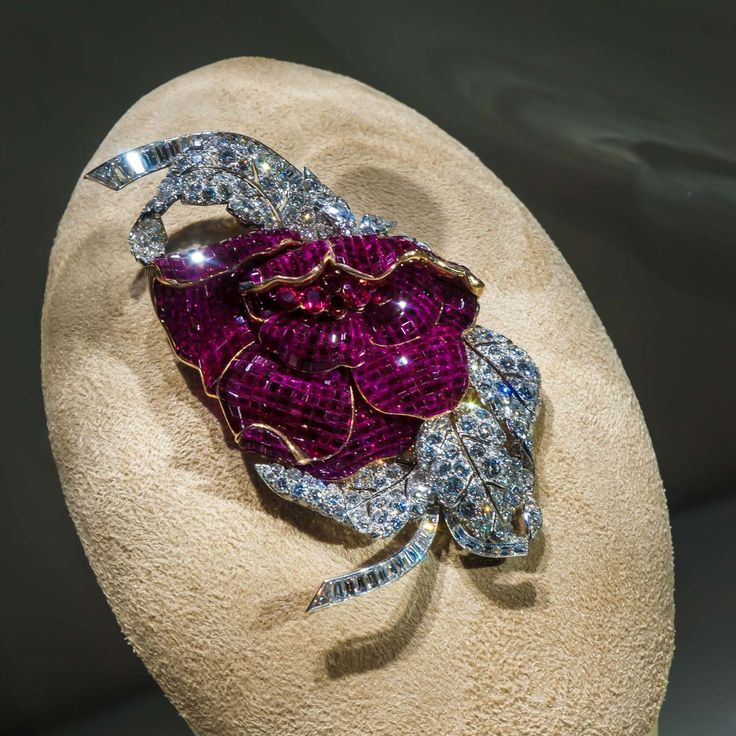 A mystery set ruby and diamond peony clip by Van Cleef and Arpels.