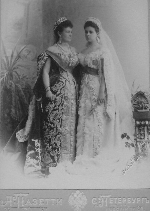 The Grand Duchess Vladimir wearing the tiara she commissioned from Bolin. She is photographed with her only daughter, Elena, who married Prince Nicholas of Greece. She sold the tiara to Queen Mary in 1921. Her daughter Marina married the Queen's uncle, the Duke of Kent. Note the grandeur and sumptuousness of their Court dress.