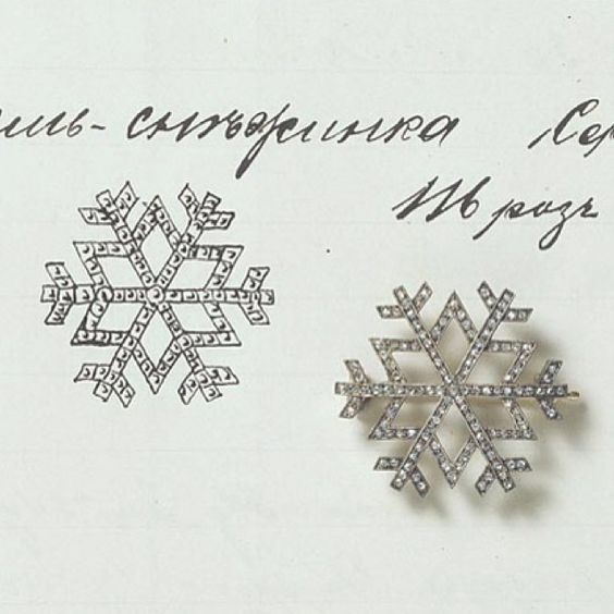 Platinum and diamond snowflake pendant by  Fabergé pictured next to its entry in the stock book.
