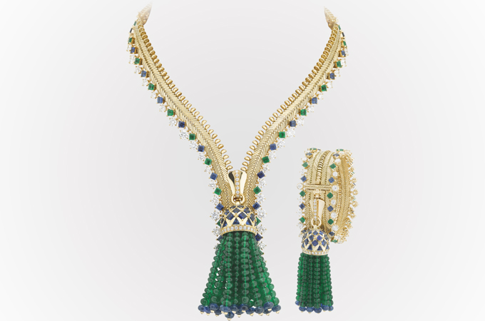 Engineering perfection: Van Cleef and Arpels zip necklace in yellow gold, sapphires, diamonds and emeralds.  It can also be worn round the wrist as a bracelet.