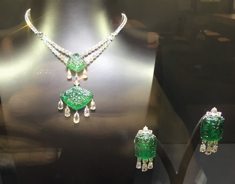 Carved gemstones are making a comeback as exemplified in this emerald and diamond set by Bayco.