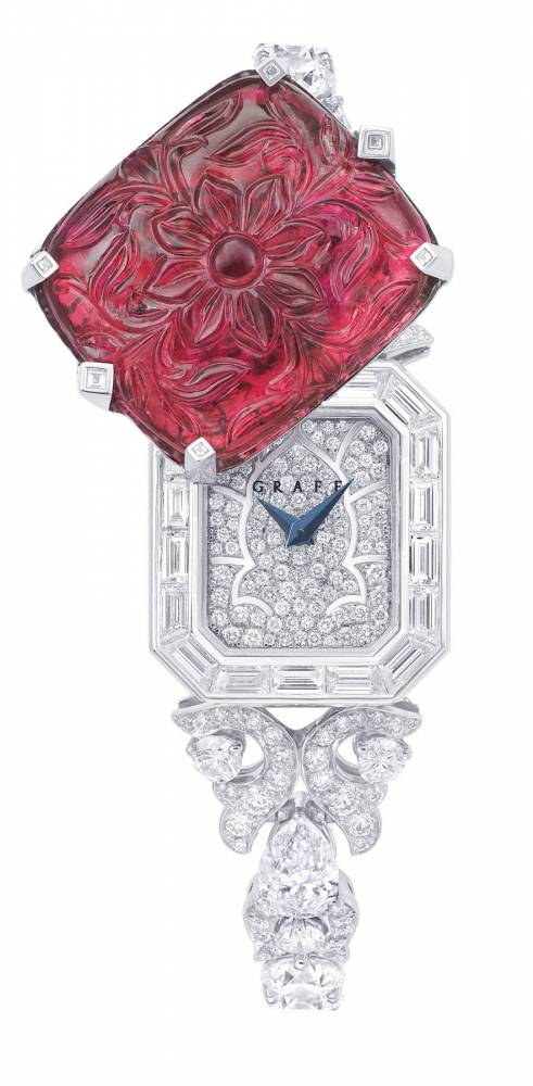 An exceptional carved ruby and diamond watch by Graff.