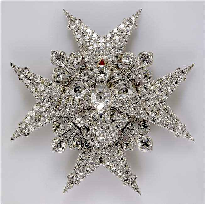 The Cross of the Order of the Saint Esprit rendered in diamonds. Note how the dove, symbol of the Holy Spirit has been picked out in gems, the beak with a single ruby.