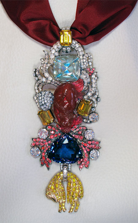 A replica of Louis XV's Order of the Golden Fleece, set with paste copies of the Cote de Bretagne spinel and the French Blue diamond, which was to pass into history as the infamous Hope diamond.