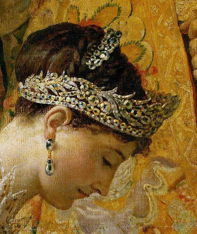 Detail of the Empress Josephine at her coronation.  Note how low the tiara sits on her brow according to fashion.  Note also the diamond comb and huge earrings.