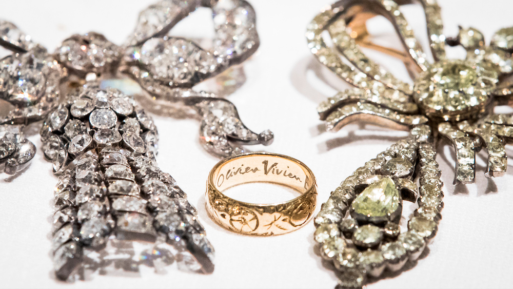 The engraved eternity band given to Vivien Leigh by Laurence Olivier, nestling among two important bow brooches.  The brooch on the left is the most valuable item in the sale, estimated to fetch £35,000-£40,000.