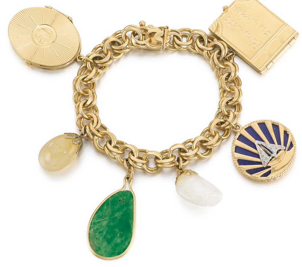Vivien Leigh's charm bracelet marking important milestones in her life.  The gold 'Gone With the Wind' book charm opens to reveal the names 'Scarlett' and 'Vivien' engraved inside.