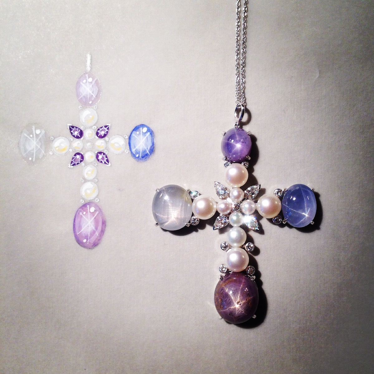 A star ruby, star sapphire, diamond and pearl cross by Luis Miguel Howard.  Note the difference in colour in the star rubies and sapphires.