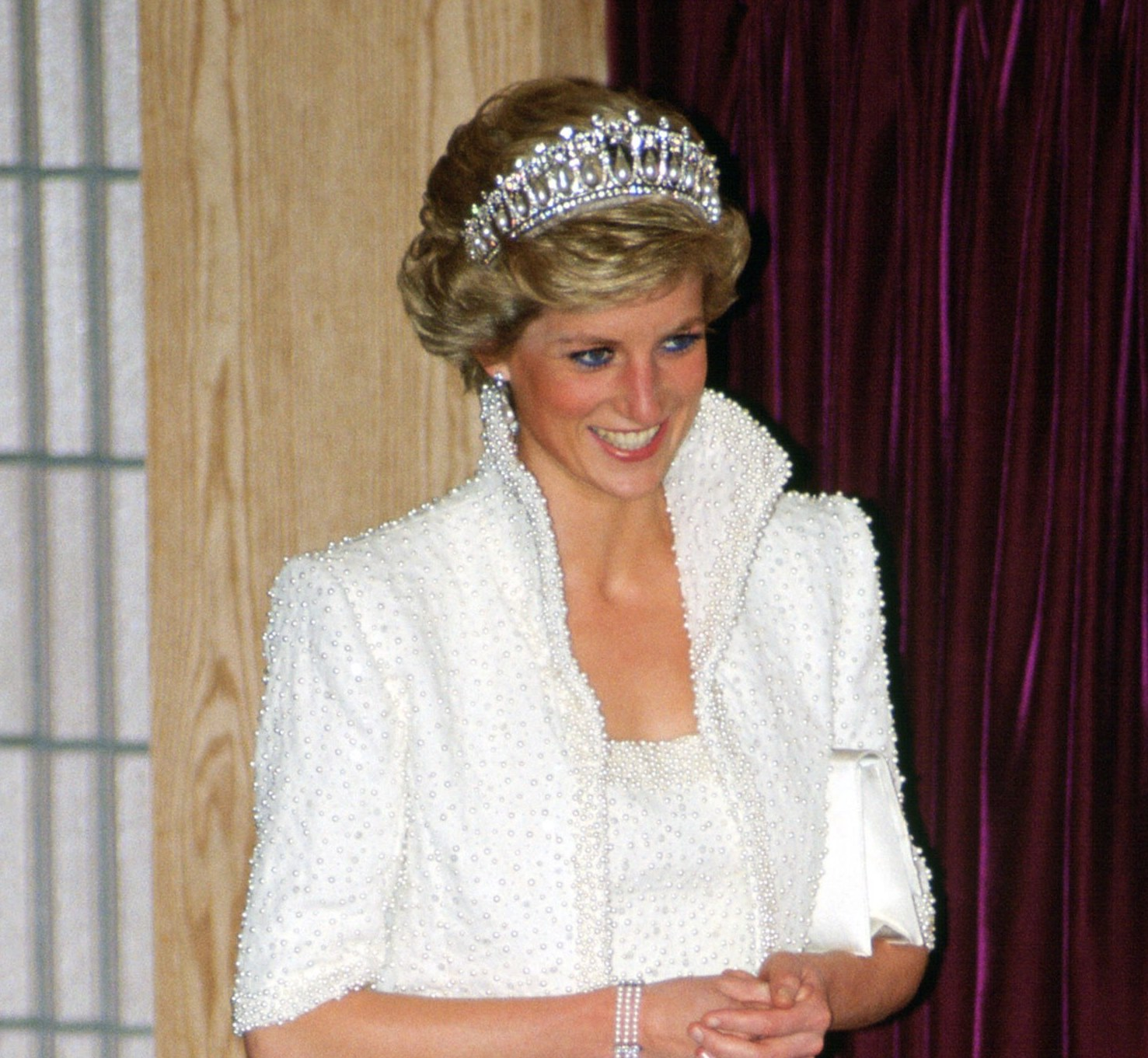 Princess Diana wearing the tiara with panache: teaming it up with a pearl bolero jacket.