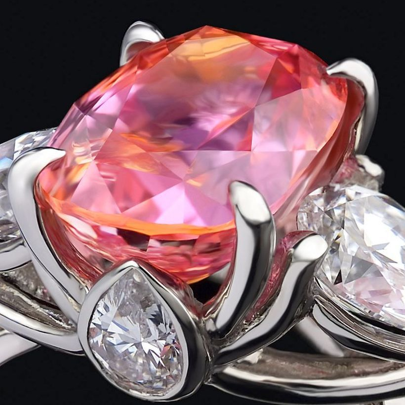 A close up view of an exceptional padparadscha sapphire, showing that special mix of orange and pink which the stone needs to qualify as such.