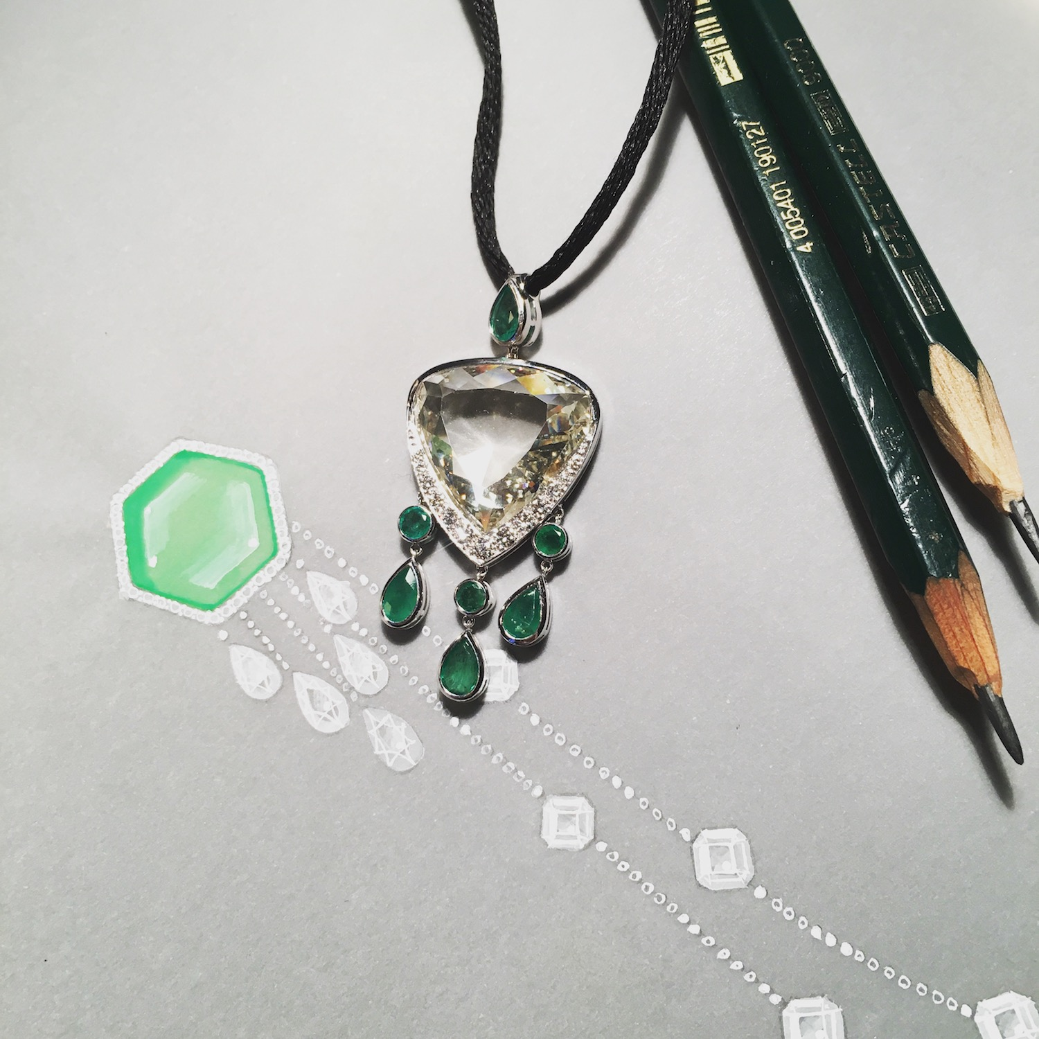 Different design concepts can be adapted to suit different stones, as can be seen here with this emerald and diamond pendant.