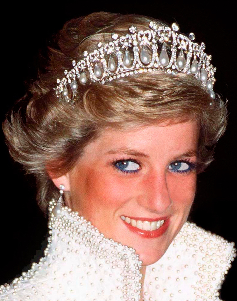 Princess Diana develops a fashion sense and good hair: wearing the Cambridge Lover's Knot tiara, a present from the Queen.