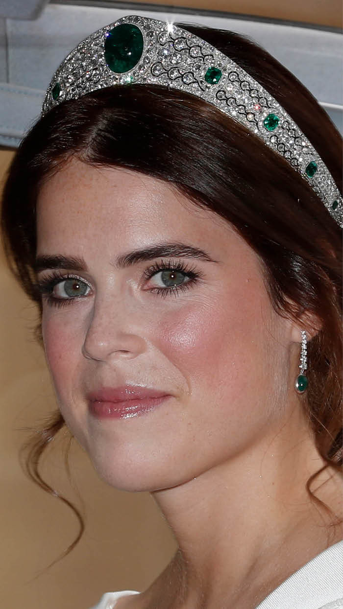 Princess Eugenie is radiant on her wedding day wearing the Greville Emerald tiara.