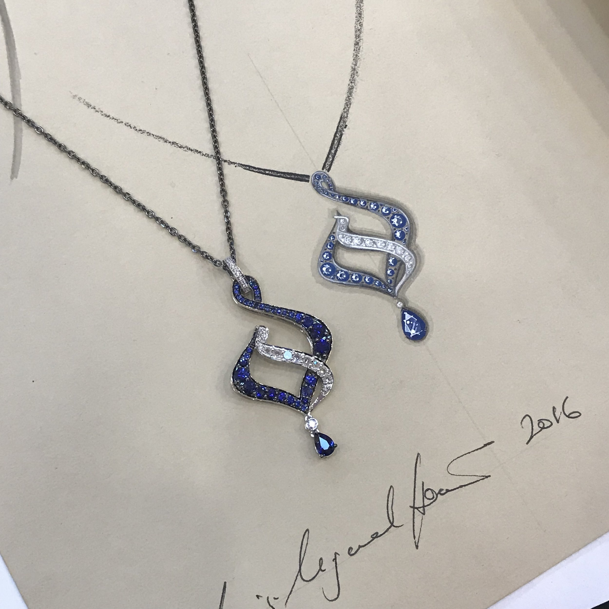'Blue Flame' pendant; inspired by Art Nouveau architecture and set with sapphires and rose cut diamonds in black gold. Shown next to its original working drawing.