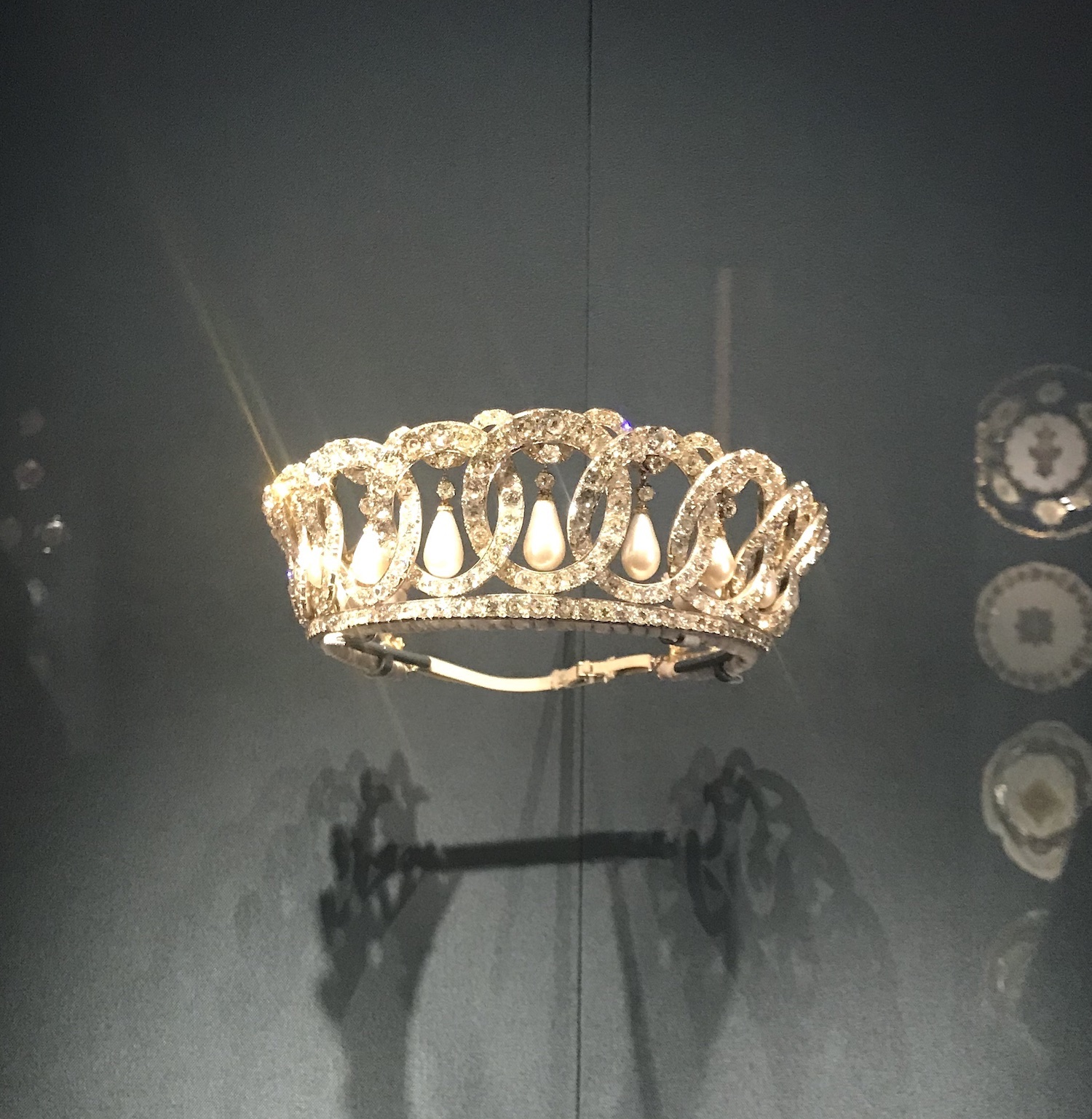 The diamond and pearl tiara commissioned by the Grand Duchess Vladimir; it was bought by Queen Mary and left to her granddaughter, Queen Elizabeth II. It is currently on show at the Queen's Gallery in Buckingham Palace as part of the Russia, Royalty and the Romanovs exhibition.