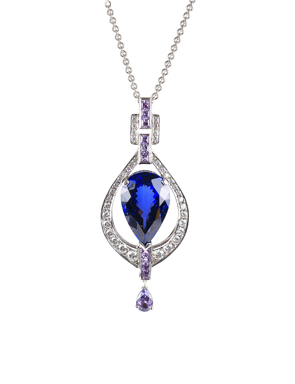 A fine example of a tanzanite, set in white gold with diamonds and embellished with lilac sapphires.