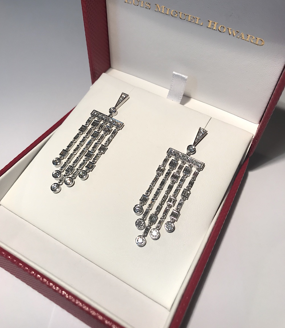 A pair of diamond fringe earrings using the client's own stones.