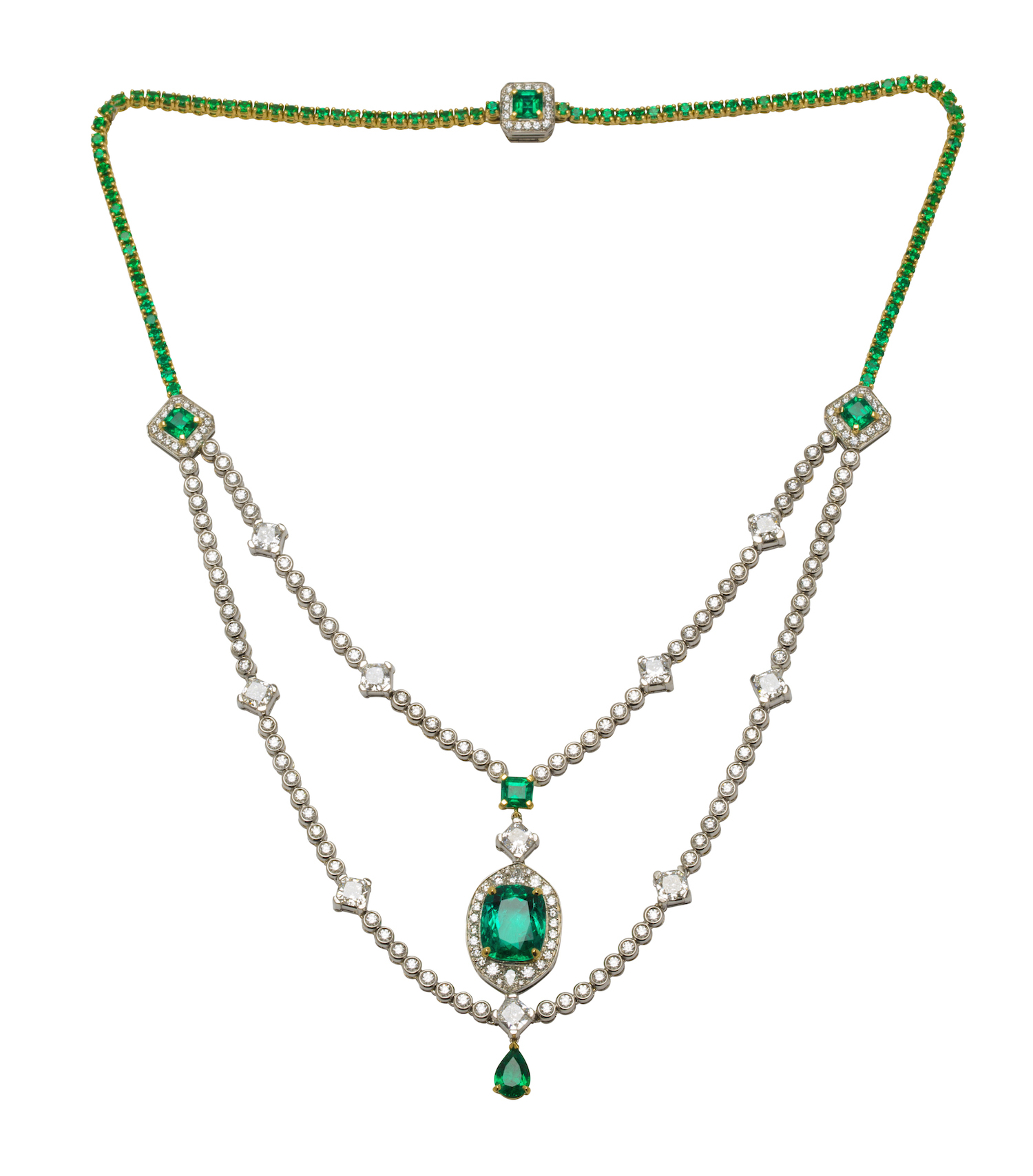An emerald and diamond necklace, composed of a double strand of round and cushion cut diamonds; the centre stone an important Colombian cushion cut emerald.
