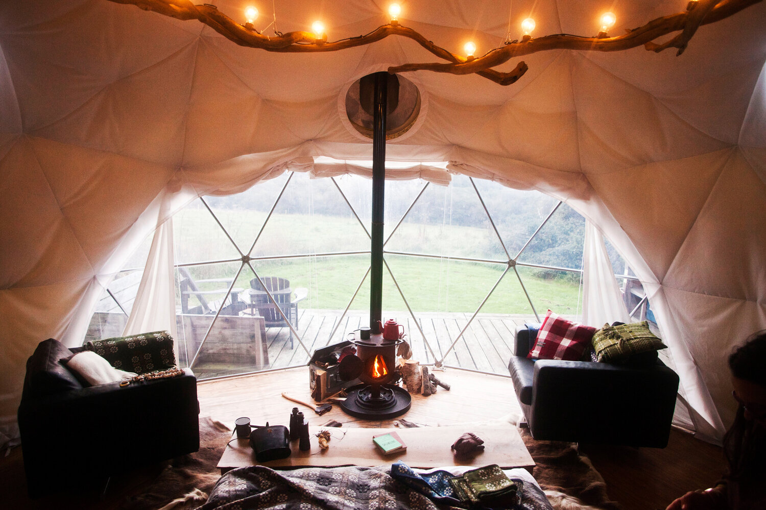 Dome - The dome, made famous at fforest, with its solid wood floor, wood-burning stove, bespoke furnishings and the view from that giant bay window.They have a king size bed, two futon camp beds and are set on their own decked area with an equipped camp kitchen & seating area.Sleeps up to 4£370 per Dome