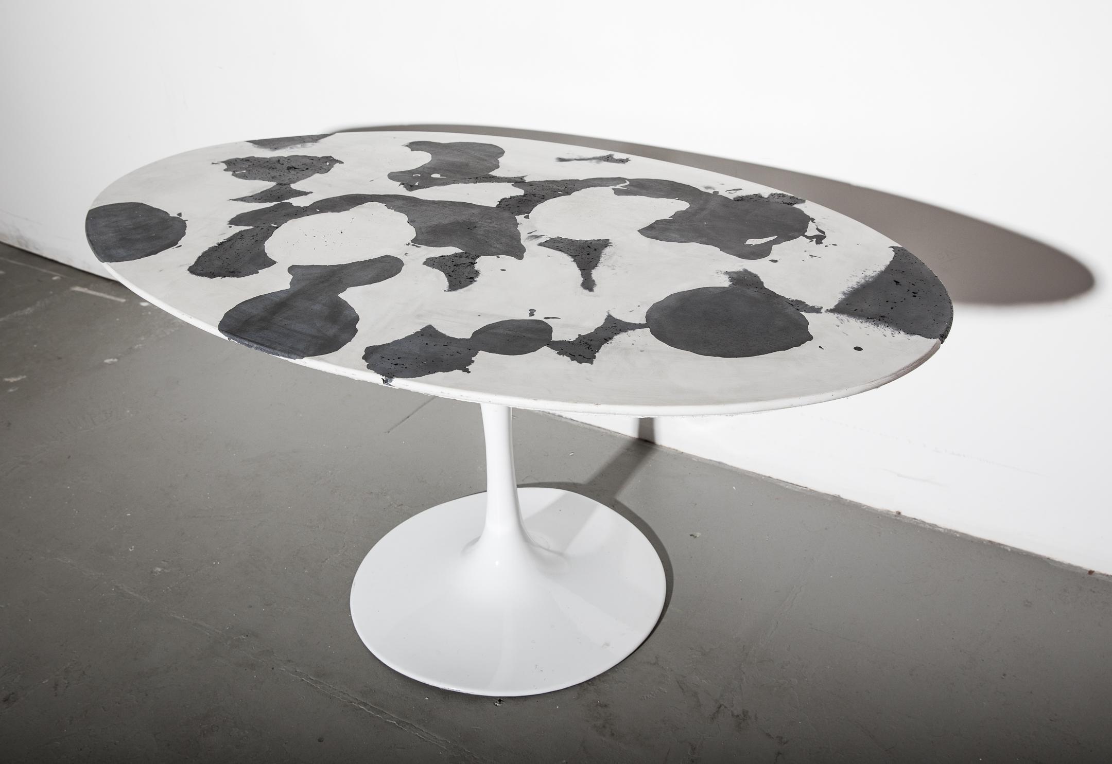 1_Patrick Cain Designs_Harvey Concrete Tulip Table_Cowhide.jpg