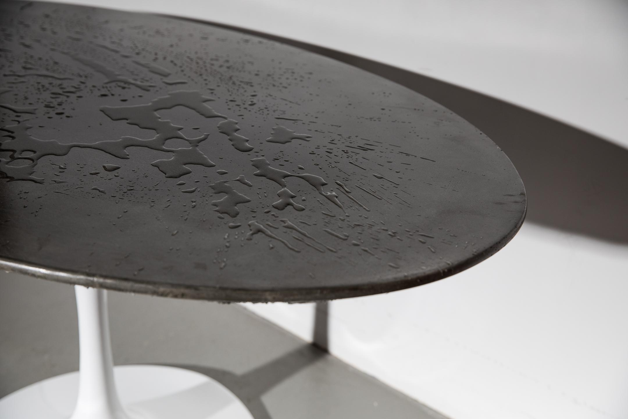 3_Patrick Cain Designs_Harvey Concrete Tulip Table_Cowhide.jpg