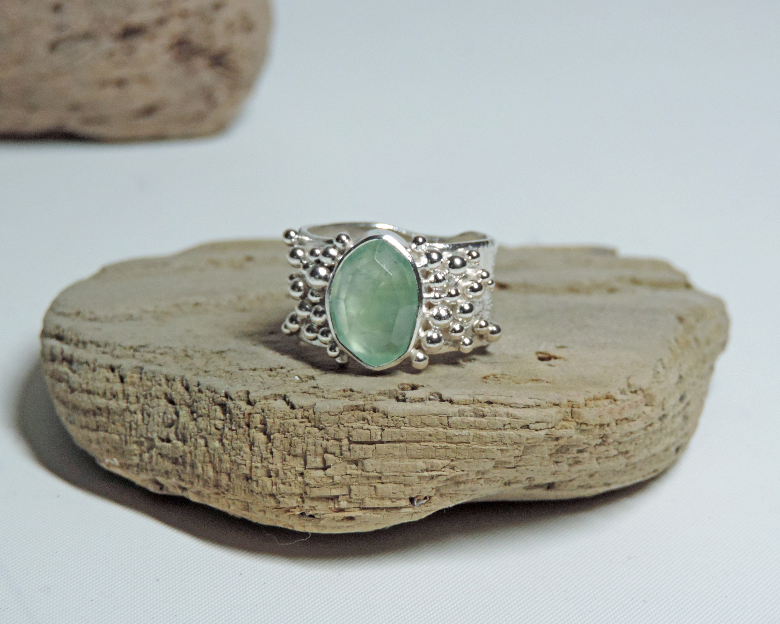 Large silver bauble ring with mint green tourmaline rose cut stone.